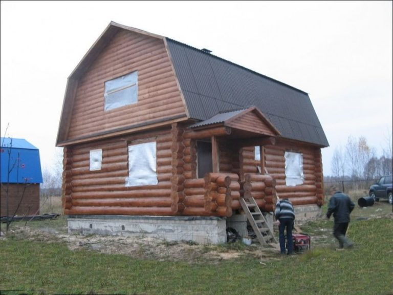 дом из сруба с ломаной крышей фото